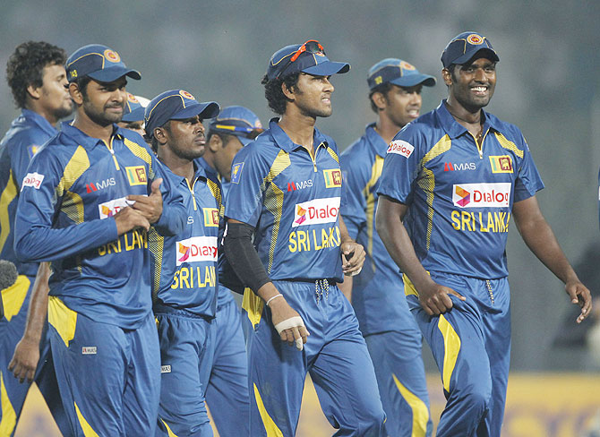 The Sri Lankan team celebrates a win