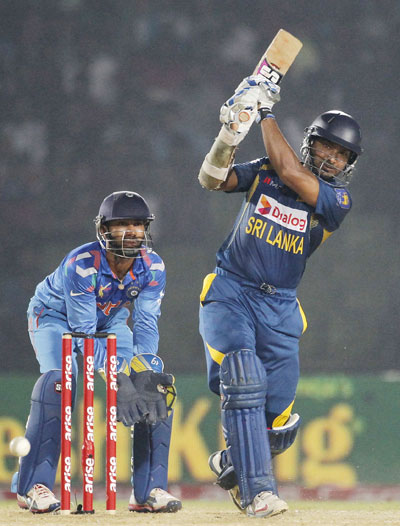 Kumar Sangakkara hits a boundary against India