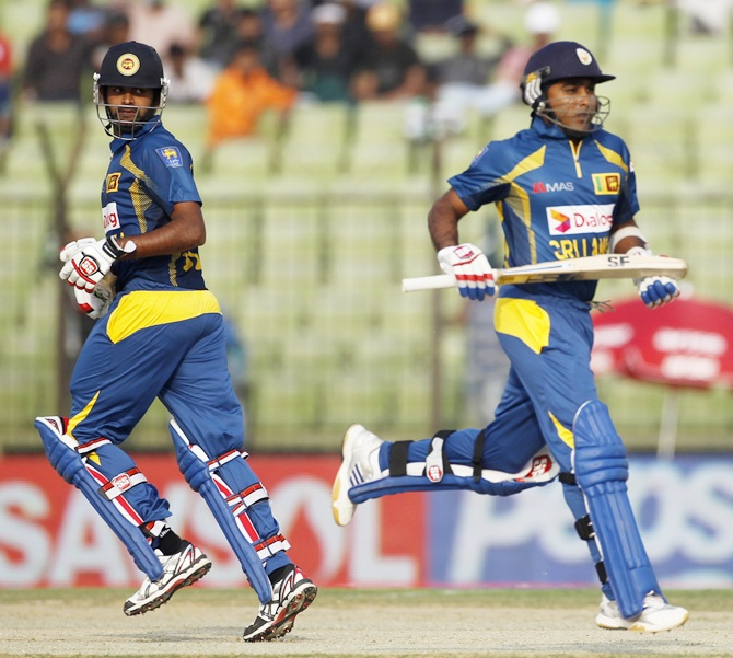 Sri Lanka's Lahiru Thirimanne and Mahela Jayawardene, right, run between the wickets against Pakistan.
