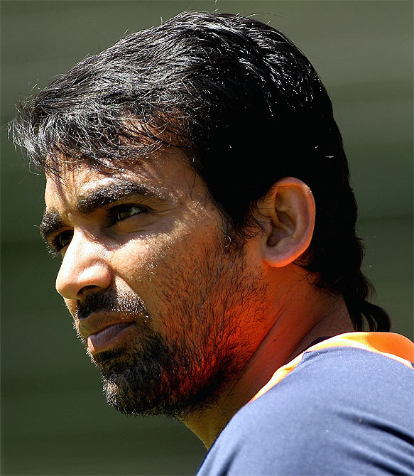 Zaheer Khan looks on during a nets session