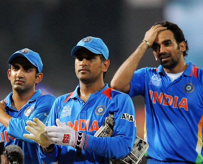 India captain Mahendra Singh Dhoni (centre) with Gautam Gambhir (left) and Zaheer Khan