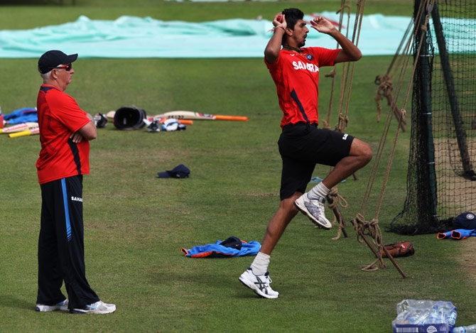Ishant Sharma bowls as coach Duncan Fletcher watches during a Team India nets session.