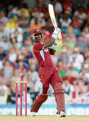 Darren Sammy of the West Indies hits six runs during the 2nd T20 International match against England at Kensington Oval in Bridgetown, Barbados on Tuesday