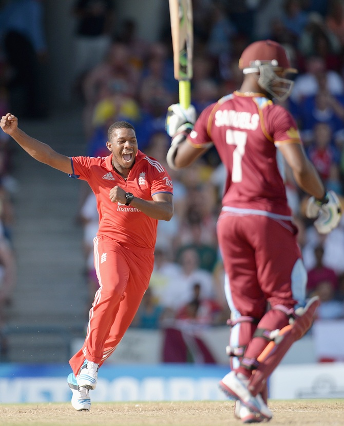 Chris Jordan of England celebrates with teammates after dismissing Johnson Charles of the West Indies