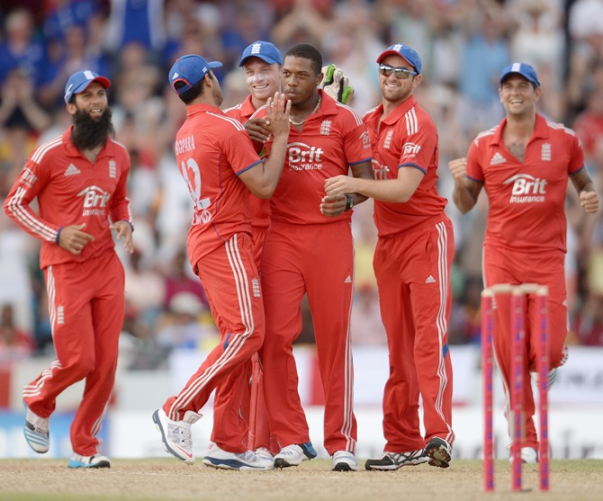 Chris Jordan of England celebrates dismissing Marlon Samuels of the West Indies
