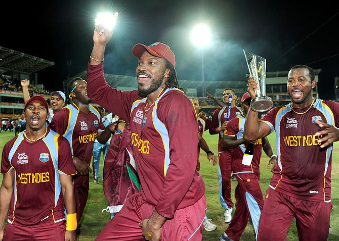 Chris Gayle (centre) celebrates with his team mates after winning the World T20 title in October 2012