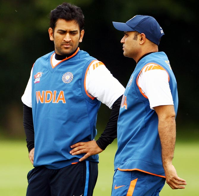 Virender Sehwag (right) speaks to India captain Mahendra Singh Dhoni