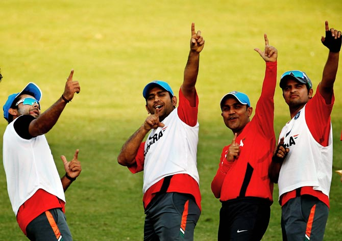 Left to right: Virat Kohli, Mahendra Singh Dhoni, Virender Sehwag and Suresh Raina during a training session.