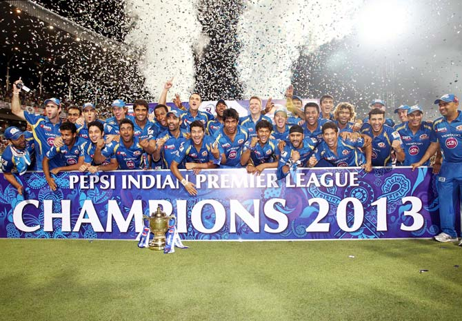 Mumbai Indians celebrate after winning the 2013 IPL