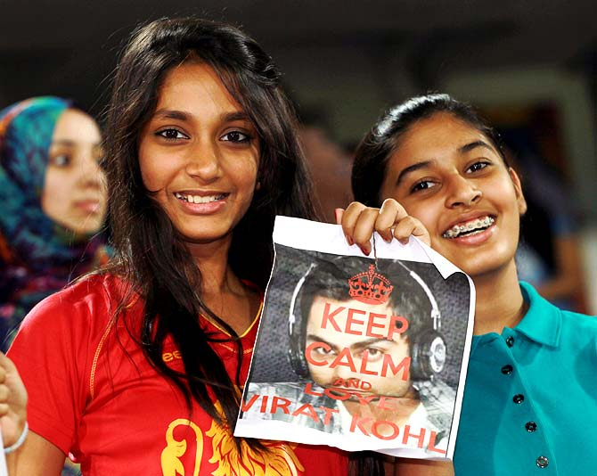 Young fans cheer for Virat Kohli during the IPL