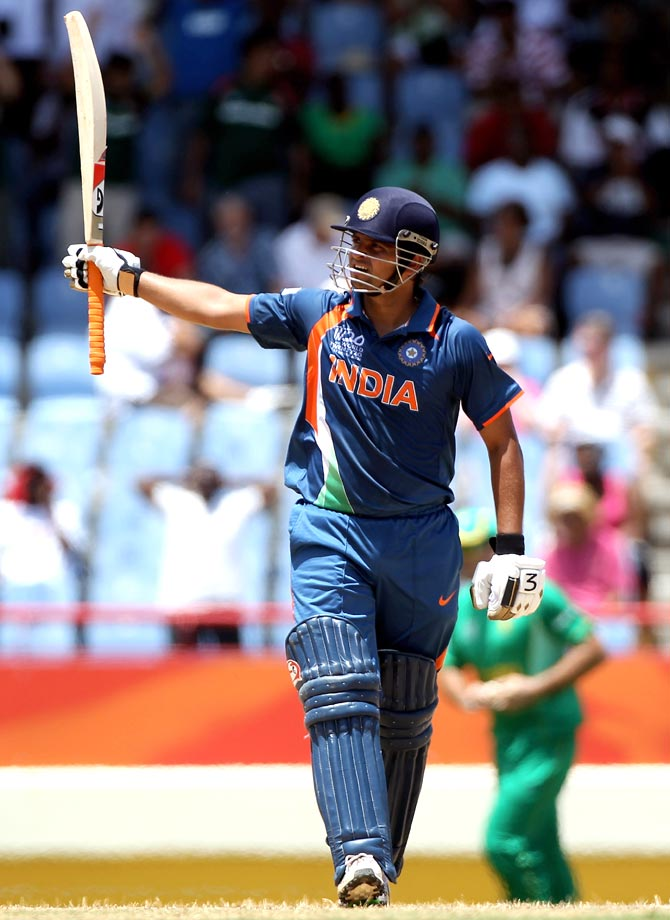 Suresh Raina celebrates his century during a 2010 World Twenty20 game against South Africa.
