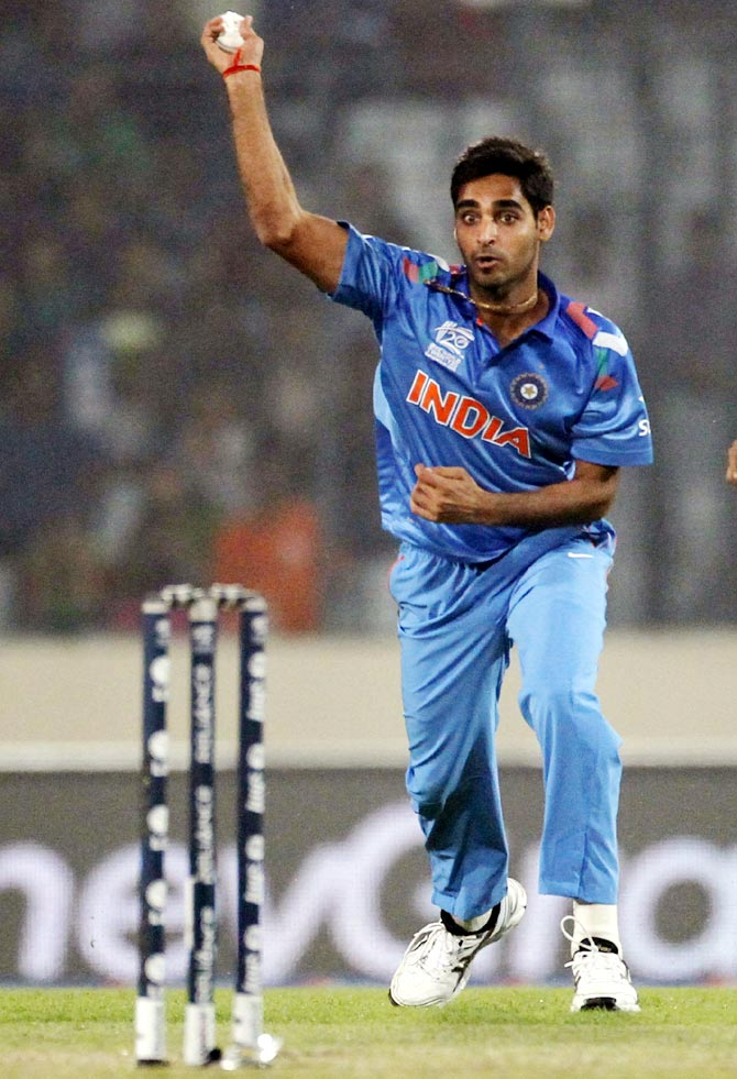 Bhuvneshwar Kumar throws the ball and break the wickets to dismiss Kamran Akmal in the ICC Twenty20 World Cup at the Sher-E-Bangla National Cricket Stadium in Dhaka