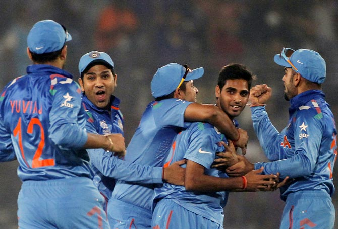Bhuvneshwar Kumar (second from right) is congratulated by his teammates after catching Mohammad Hafeez