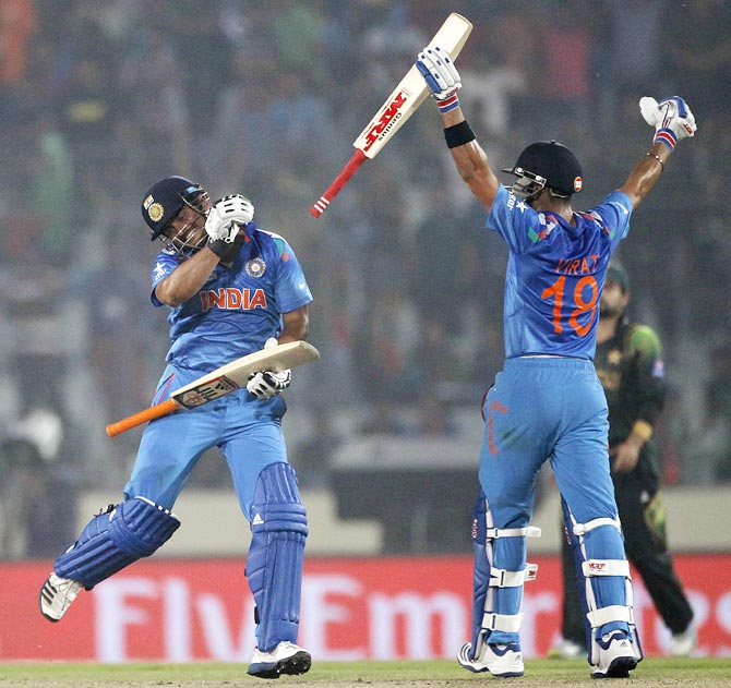 Virat Kohli, right, and Suresh Raina celebrate India's victory against Pakistan
