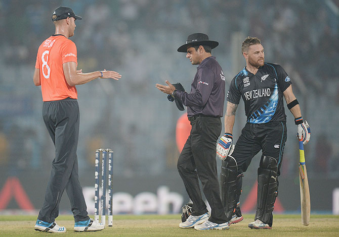 England captain Stuart Broad speaks with umpire Aleem Dar and Brendon McCullum of New Zealand before the game is stopped for rain during the ICC World Twenty20 Group 1 match at Zahur Ahmed Chowdhury Stadium in Chittagong on Saturday
