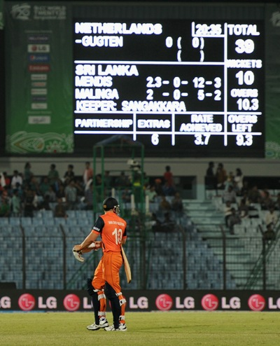 Timm van der Gugten of the Netherlands leaves the field after his team is bowled out for 39 runs