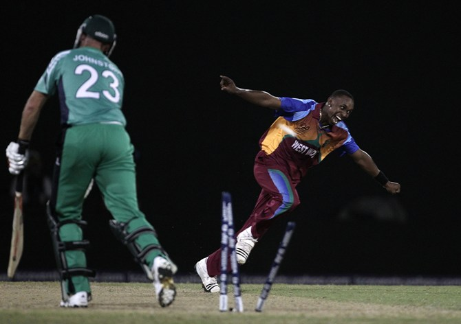 Dwayne Bravo of West Indies celebrates the wicket of Trent Johnston of Ireland v Guyana