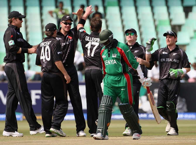Steve Tikolo of Kenya leaves the field as the New Zealand team celebrate his wicket