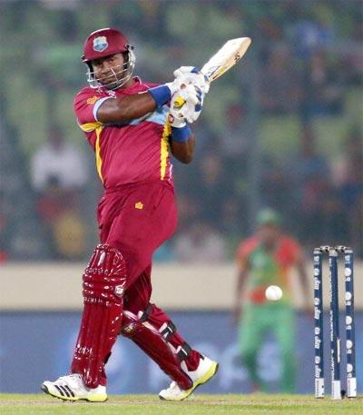 West Indies crush Bangladesh to keep semis hopes alive