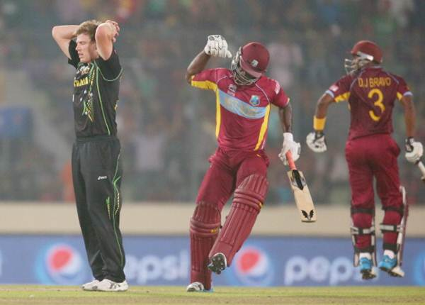 Australia pacer James Faulkner reacts as Darren Sammy (centre) of the West Indies hits a six in the final over during the ICC World Twenty20 Bangladesh 2014 on Friday.