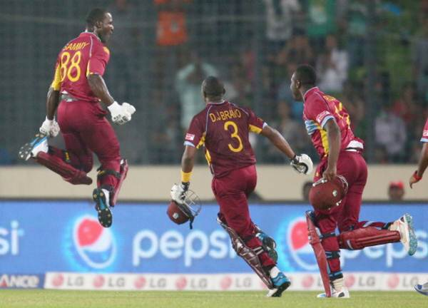 Darren Sammy is congratulated by teammates after hitting the winning runs