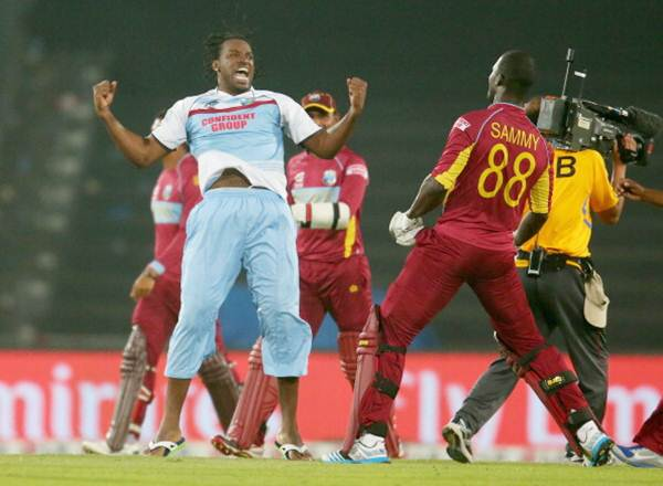 Chris Gayle and the West Indies players celebrate after Sammy clinches victory