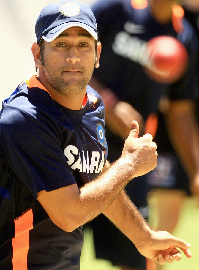 MS Dhoni bowls in the nets during an Indian nets session