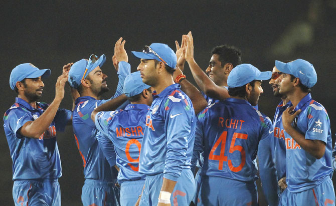 India's fielders celebrate the dismissal of Bangladesh's Shamsur Rahman