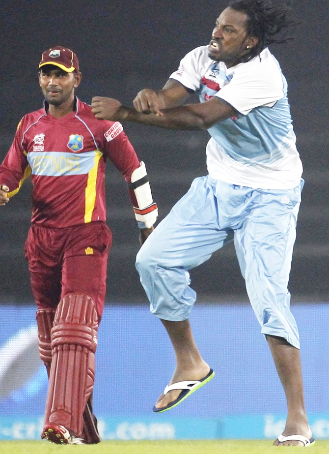 West Indies' Chris Gayle,right, celebrates victory against Australia with his teammates
