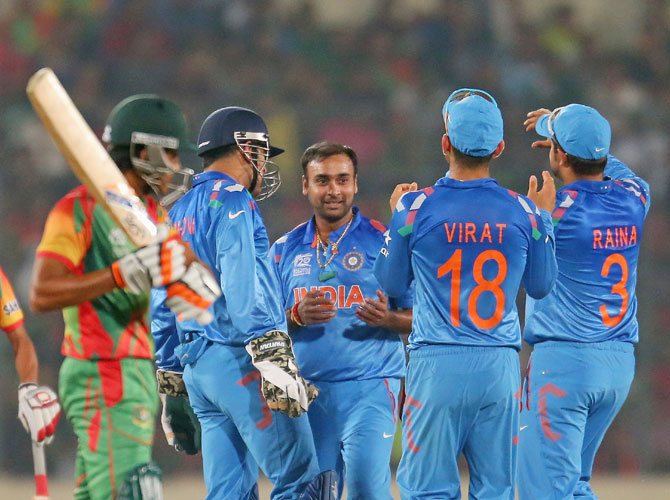 Amit Mishra is congratulated by teammates after dismissing Anamul Haque