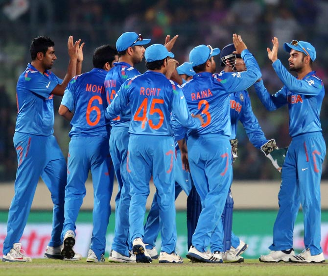 Indian players celebrate after Virat Kohli (right) takes a catch to dismiss Aaron Finch of Australia