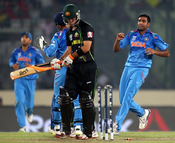 R Ashwin (right) celebrates after taking the wicket of Glenn Maxwell