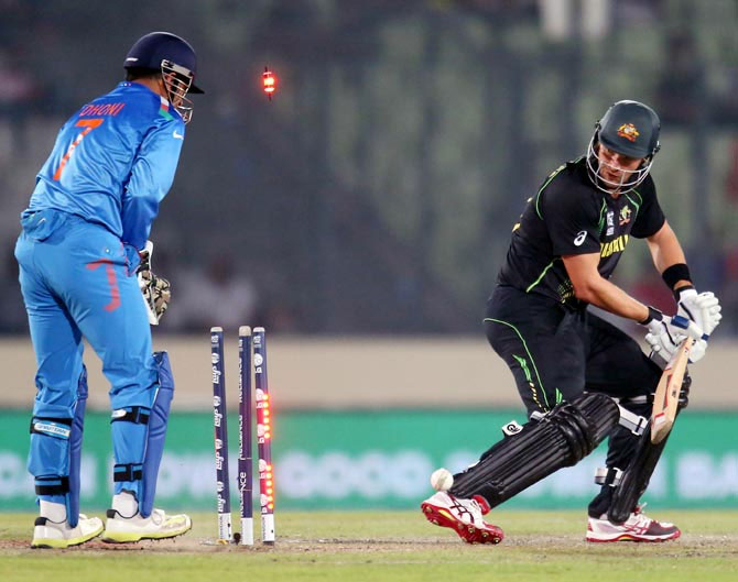 Shane Watson is bowled as Dhoni looks on