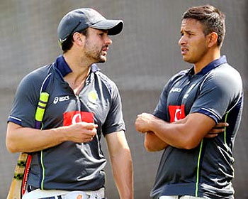 Ed Cowan (left) speaks to Usman Khawaja during a training session