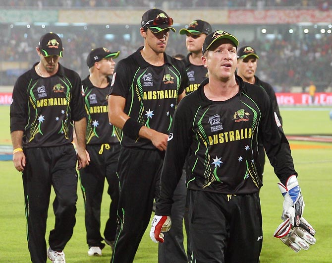 The Australian team leave the field after losing their match against West Indies at the World T20 in Dhaka
