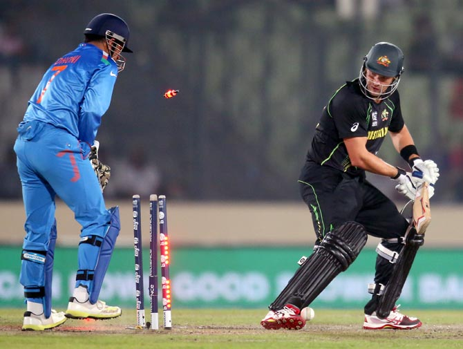 Shane Watson is bowled by Mohit Sharma as wicketkeeper Mahendra Singh Dhoni looks on.