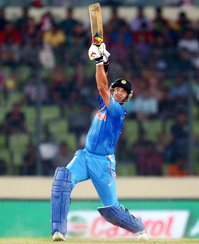 Yuvraj Singh lofts on during the match against Australia on Sunday