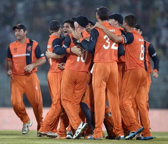 Netherlands players celebrate after winning the match against England.