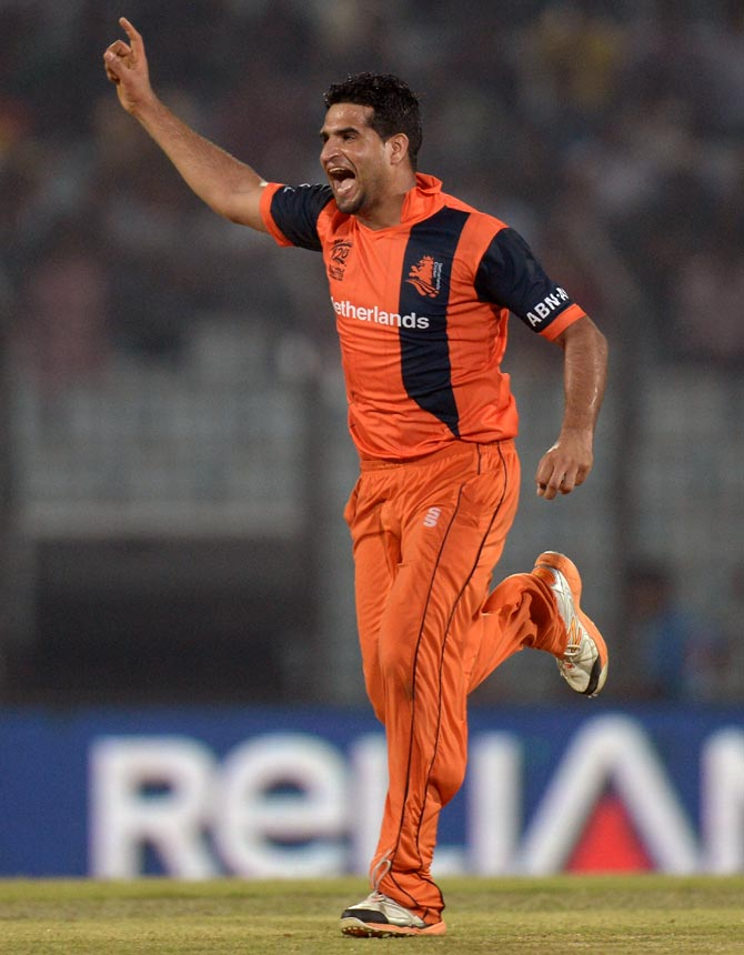 Mudassar Bukhari of the Netherlands celebrates dismissing England captain Stuart Broad
