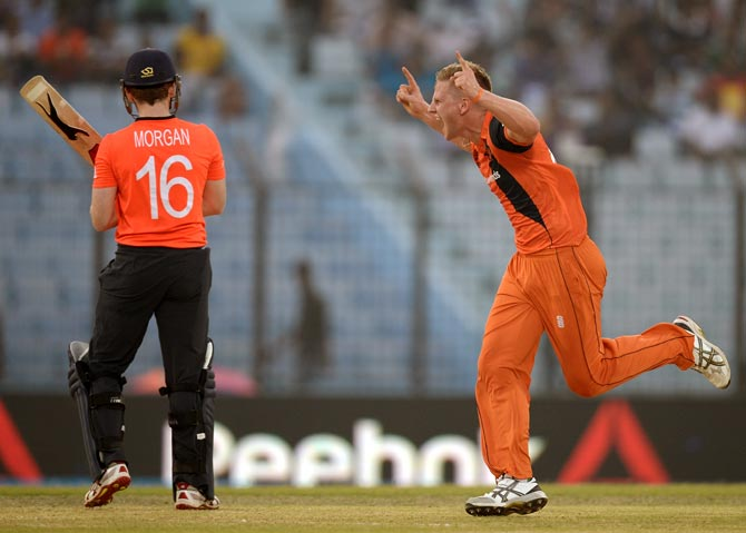 Timm van der Gugten of the Netherlands celebrates the wicket of Eoin Morgan