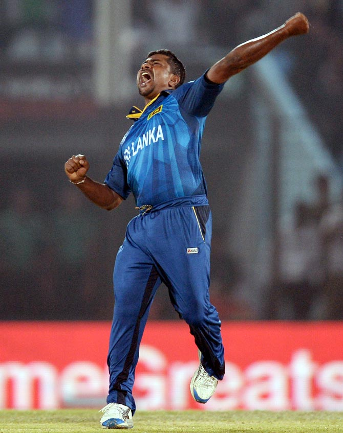 Rangana Herath of Sri Lanka celebrates dismissing New Zealand's Luke Ronchi