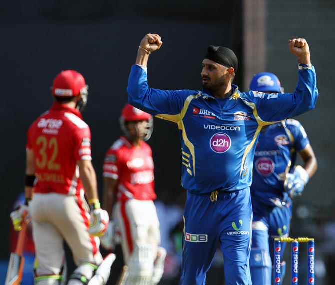 Harbhajan Singh celebrates after getting the wicket of Glenn Maxwell