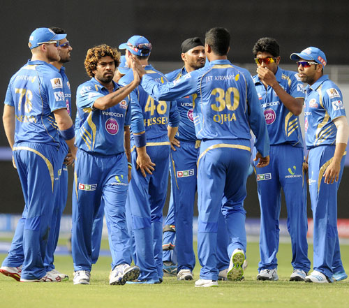 Lasith Malinga is congratulated by Mumbai Indians teammates after taking a wicket