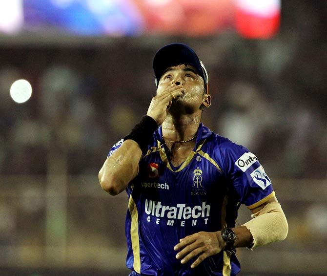 Pravin Tambe celebrates after winning the match
