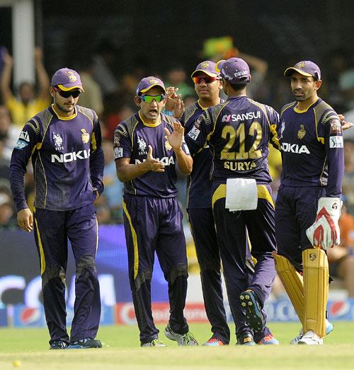 Kolkata Knight Riders players celebrate a wicket
