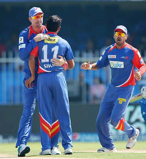 Delhi Daredevils players celebrate a dismissal