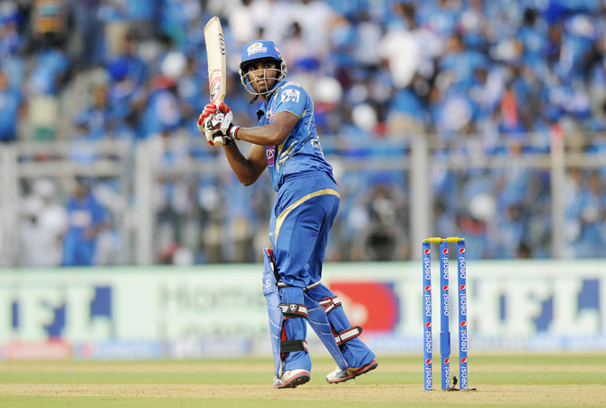 Chidambaram Gautam of Mumbai Indians hits a shot
