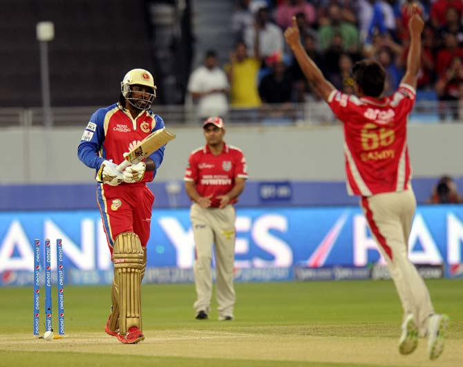 Chris Gayle being cleaned up by Sandeep Sharma
