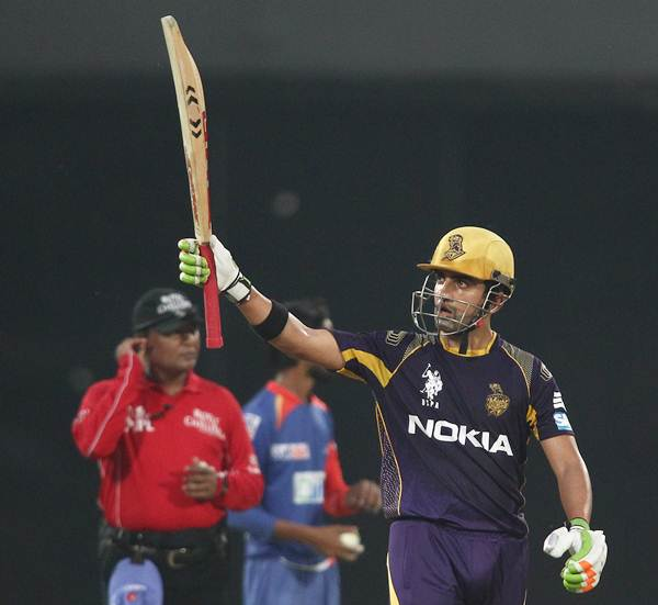 Gautam Gambhir acknowledges the applause of the crowd after getting to fifty.
