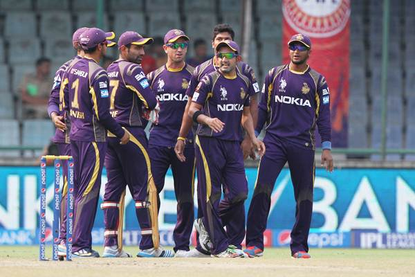 Kolkata Knight Riders captain Gautam Gambhir celebrates with teammates the dismissal of Delhi Daredevils' opener Quinton de Kock.